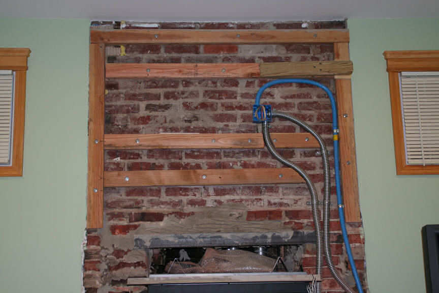 Next weekend: Rebrick lower half up to mantel, add in lintel across to  carry weight of mantel, notch it to allow space for 3 tubes, face the top  hald in ... - Converting Wood Burning Fireplace To Gas